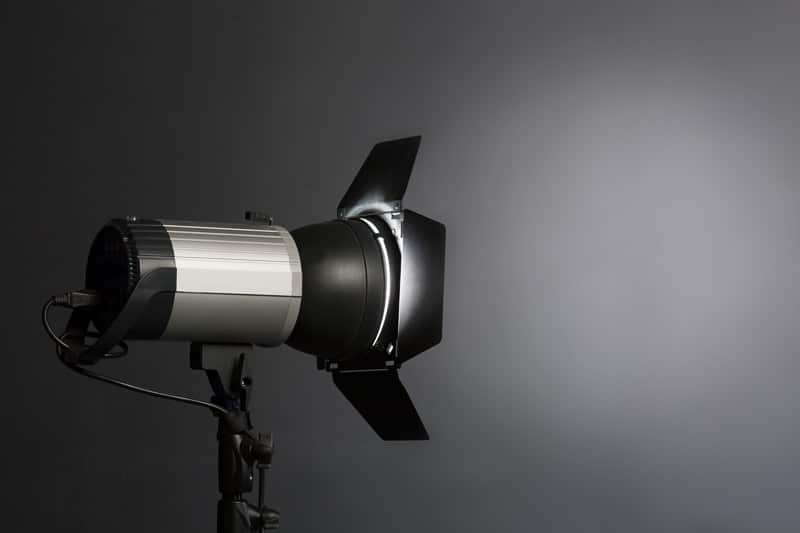 modern source of pulsed light with a reflector on a dark backgro